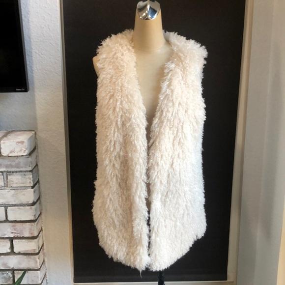 Decree ivory fussy vest.